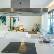 Botanic Los Arqueros new project_Living room with open plan kitchen_Realista Quality Properties Marbella