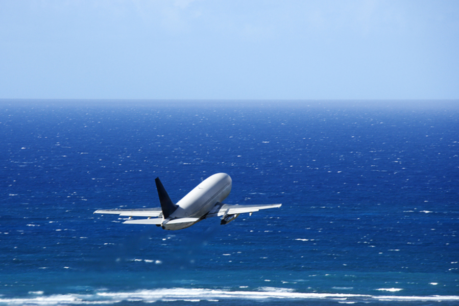 Airplane over ocean