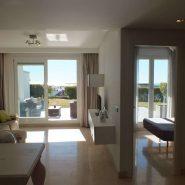 Los Robles_Los Arqueros_ Benahavis_Ground floor apartment living room terrace view_Realista Quality Properties Marbella