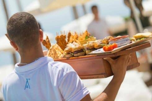 Nikki Beach waiter with food
